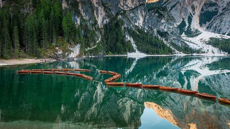 Wooden boats on Lago di Braies in Dolomites, Italy