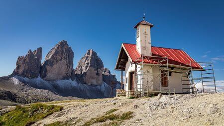 Stunning Tre Cime peaks and Chiesetta Alpina, Dolomites, Italy