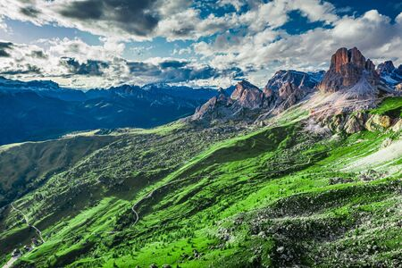 Green hills and Passo Giau in Dolomites, aerial view