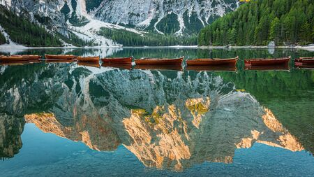 Famous Lago di Braies and wooden boats in Dolomites, Italy