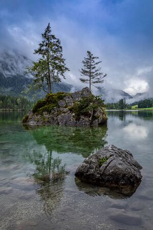 Misty mountain lake Hintersee in Berchtesgaden national park