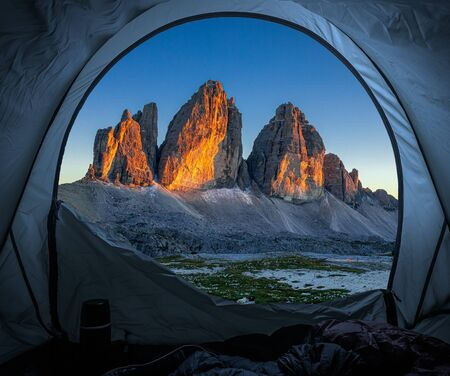 Camping in tent at Tre Cime at sunset, Dolomites Stock Photo