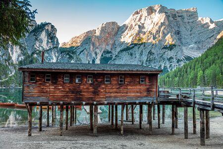 Breathtaking wooden hut on Lago di Braies, Dolomites Stok Fotoğraf