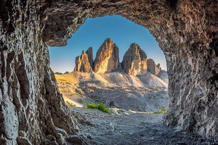 Stunning view to Tre Cime di Lavaredo from cave, Dolomites Stock Photo