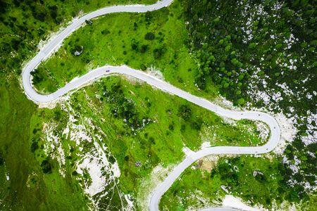 White serpentine between green hills, Dolomites, Italy Stok Fotoğraf
