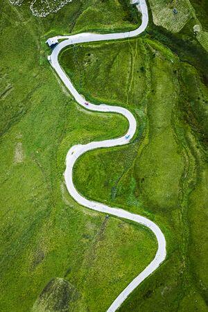White serpentine on green hills in Dolomites 写真素材