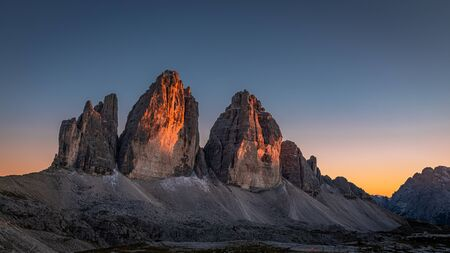 Beautiful view to Tre Cime peaks at sunset, Dolomites, Italy