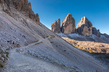 Breathtaking view to path and Tre Cime peaks at sunrise