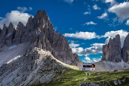 Aerial view to Tre Cime and Dreizinnen hut, Dolomites Stock Photo