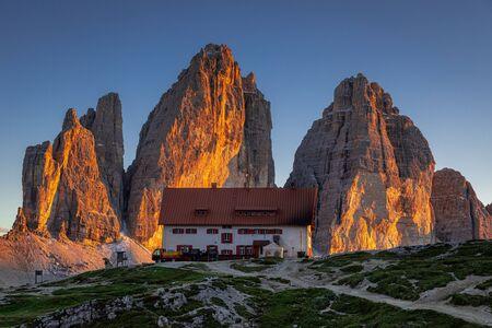 Stunning view to Tre Cime di Lavaredoin Dolomites at sunset