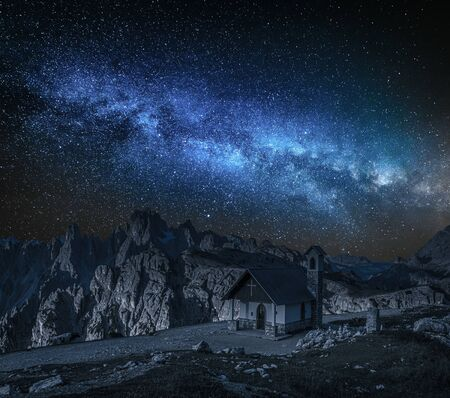 Milky way over small chapel in Tre Cime, Dolomites