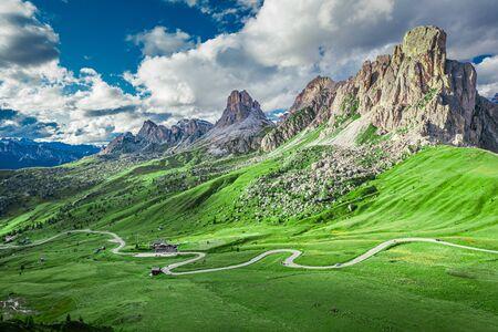 Passo Giau and Averau peak in green Dolomites, aerial view