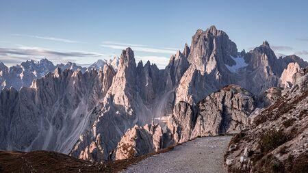 Mountains trail to Tre Cime di Lavaredo at sunrise, Dolomites Stock Photo