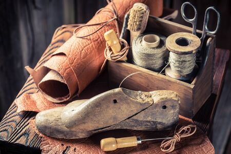 Closeup of shoemaker workshop with shoes and laces