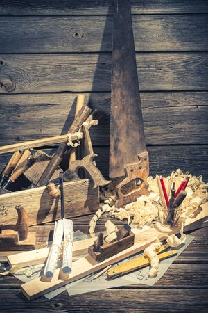 Closeup of vintage carpenter drawing desk in rustic wooden shed