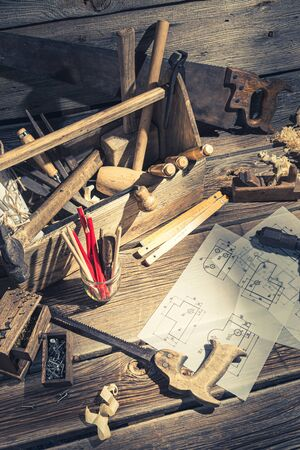 Drawing desk in carpenter workshop in rustic wooden shed Фото со стока