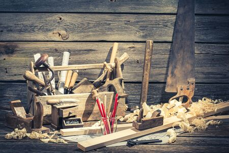 Old carpentry workbench and drawing workshop in rustic wooden shed