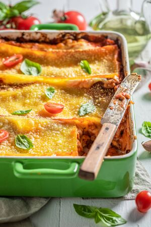 Spicy lasagna with bolognese, parmesan and basil