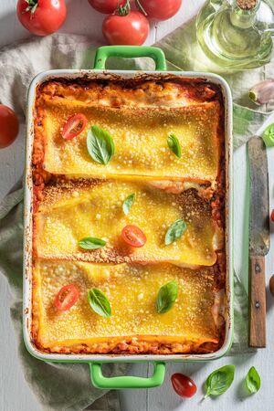 Homemade lasagna baked in casserole with cheese