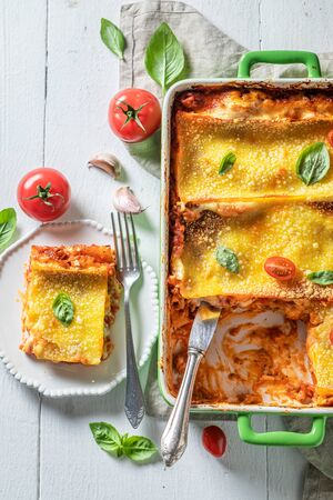 Spicy lasagna made with bechamel sauce and bolognese Фото со стока