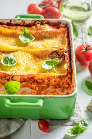 Tasty lasagna with bechamel sauce, tomatoes and herbs Фото со стока - 133463726