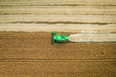 Top down view of harvester working on field, aerial view