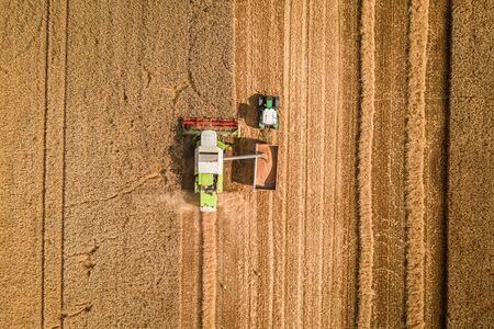 Top down view of big harvester on field in summer