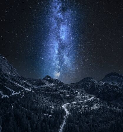 Milky way over Passo Falazarego at night in Dolomites