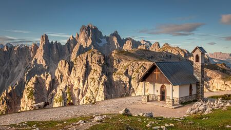 Mountain trail to Tre Cime and small chapel, Dolomites Stock Photo