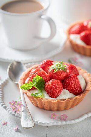 Sweet mini tart with fresh strawberries and mint