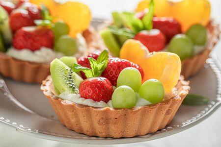 Closeup of mini tart made of summer fruits and cream