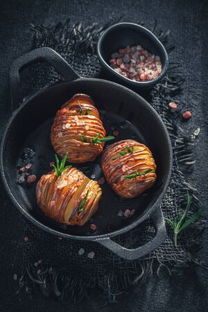 Freshly baked Hasselback with salt, herbs and oil