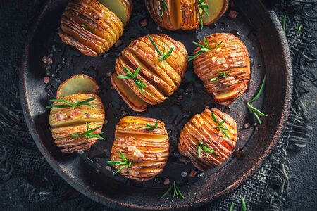 Freshly baked Hasselback made with salt and rosemary Stock Photo