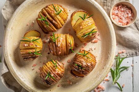 Warm baked potatoes with fresh herbs and salt