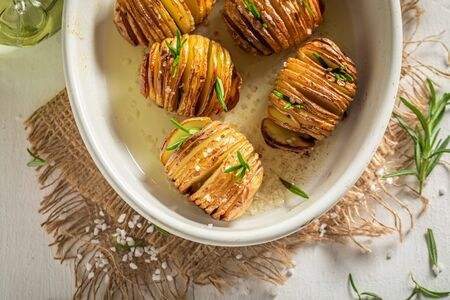 Warm Hasselback made with salt and rosemary