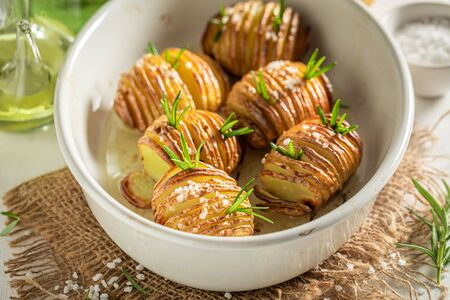 Yummy baked potatoes with salt, herbs and oil Stock Photo