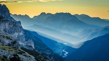View to foggy valley in Dolomites at sunrise Stockfoto