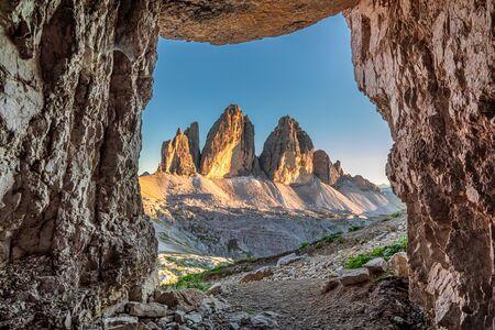 Tre Cime di Lavaredo from cave at sunset, Dolomites Banco de Imagens
