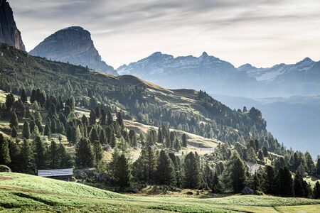 View to green valley at Passo Gardena in Dolomites, Italy