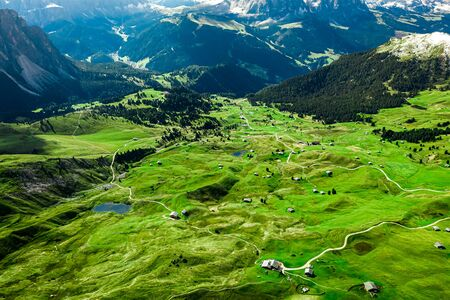 Aerial view from Seceda to green valley, Dolomites Stockfoto