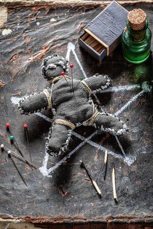 Extraordinary voodoo doll burned with fire as harming Фото со стока