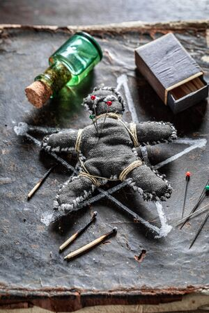 Extraordinary voodoo doll pierced by a needle as harming Фото со стока