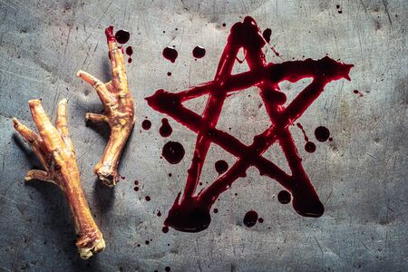 Pentagram painted with blood on a metal table