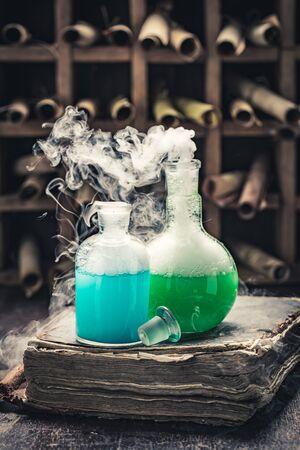 Vintage alchemist laboratory full of medieval and old scrolls