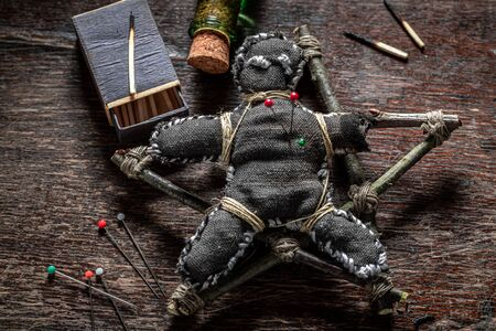 Unique voodoo doll burned with fire as harming Фото со стока