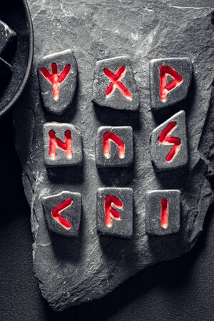 Extraordinary runic divination by stones based on antique scrolls