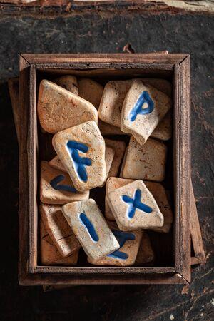 Magic divination by rune stones based on futhark alphabet