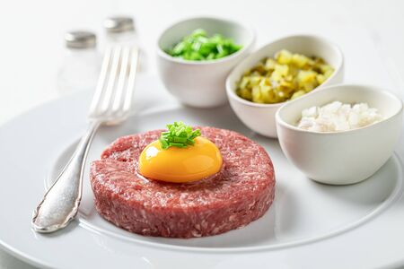 Enjoy your beef tartare with yolks, chives and pepper 写真素材