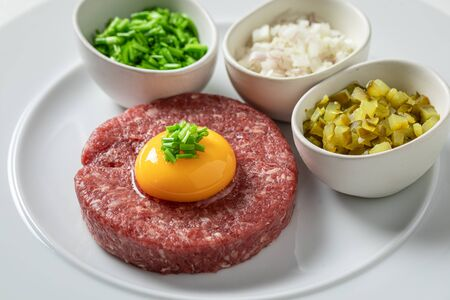 Beef tartare with yolks, chives and pepper