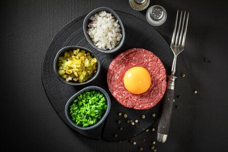 Raw beef tartare with chives, gherkin and yolk